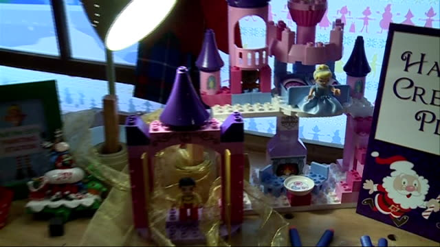hamleys announce toy shortlist for christmas 'duct tape fashion' kit / 'hamleys creative play' sign / toys laid out on table / lego castle / 'hot off... - doll stock videos & royalty-free footage