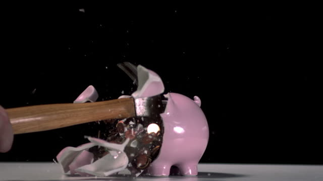 hammer breaking a piggy bank - piggy bank stock videos & royalty-free footage
