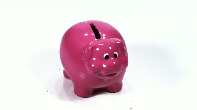 CU SLO MO Hammer breaking piggy bank / Vieux Pont, Normandy, France