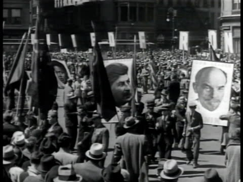 hammer sickle w/ star symbol on building ws soviet communists parading in square w/ photo posters of leaders lenin stalin an unidentified black male... - sickle stock videos & royalty-free footage