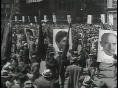 hammer & sickle w/ star symbol on building. soviet communists parading in square w/ photo posters of leaders, lenin, stalin & an unidentified black... - third reich stock videos & royalty-free footage