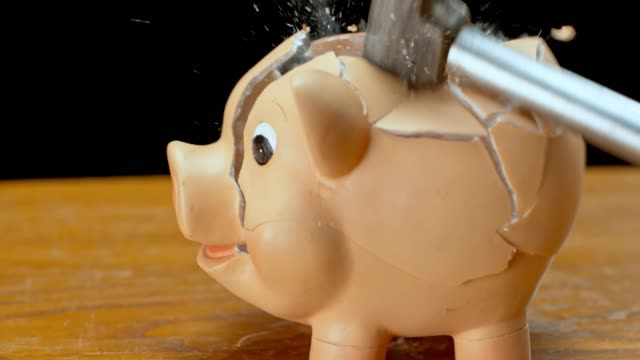 slo mo ld hammer smashing a piggy bank - piggy bank stock videos & royalty-free footage