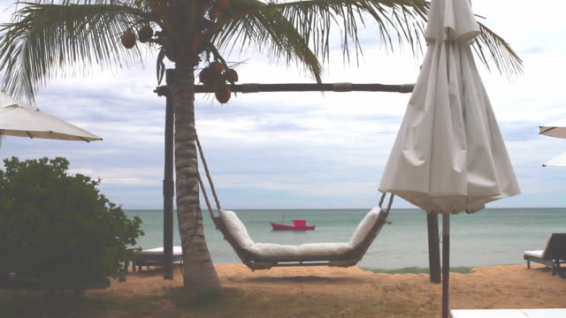 ws hammock and trees with boat in background / trancoso, bahia, brazil - bahia state stock videos & royalty-free footage