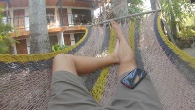 hammock pov - feet up stock videos & royalty-free footage