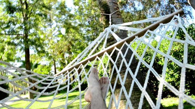 hammock relaxation - legs crossed at ankle stock videos & royalty-free footage