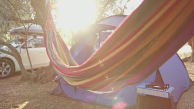 hammock swinging at sunny summer campsite - hammock stock videos & royalty-free footage
