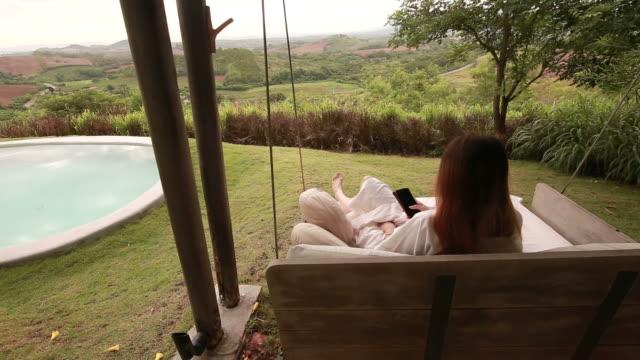 hammock waving in wind at beach resort - hot tub stock videos and b-roll footage