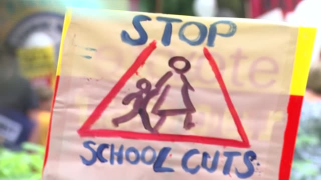 Hammond comments on public sector pay ENGLAND London EXT Various of teachers parents and children taking part in protest against cuts to school...