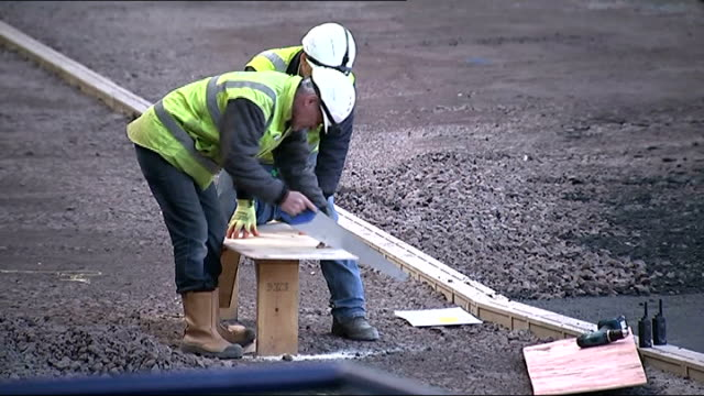 hampden park transformed ahead of glasgow 2014 commonwealth games; david grevemberg interview sot construction worker sawing wood construction... - turf stock videos & royalty-free footage