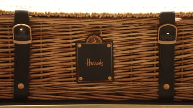 a hamper full of luxury food and drink products sits on display in the food hall at the luxury department store harrods ltd in london uk on wednesday... - hamper stock videos and b-roll footage