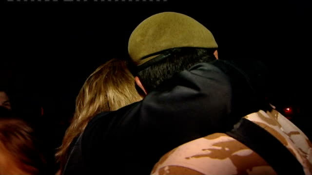 aldershot: ext/night welsh guards being welcomed home by families after six month posting in afghanistan and mother wiping away tears and saying 'i... - aldershot stock videos & royalty-free footage
