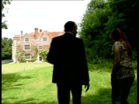 hampshire chawton house int following seq has woman's voice reading novel overlaid slow motion country house as two young women dressed in period... - jane austen author stock videos and b-roll footage