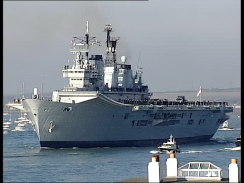 hampshire portsmouth ext hms ark royal along as ship leaving for gulf rear admiral richard cobbold interviewed sot talks about ark royal deployment... - marine stock-videos und b-roll-filmmaterial