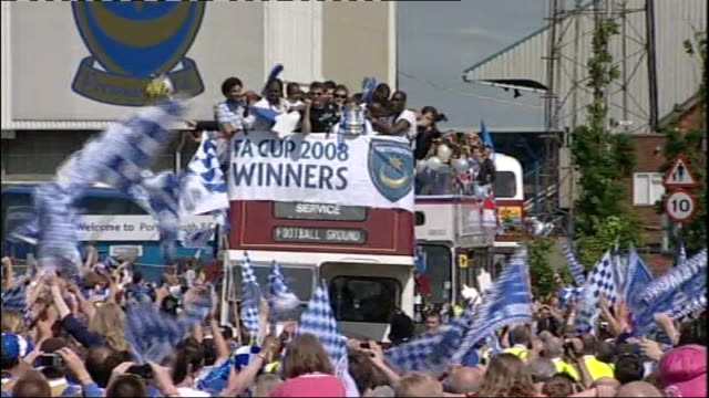 Hampshire Portsmouth EXT Portsmouth football players along on top of opentop bus to celebrate winning the FA Cup Fans celebrating