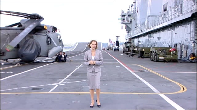 hampshire portsmouth ext reporter to camera onboard hms ark royal - ark stock videos and b-roll footage
