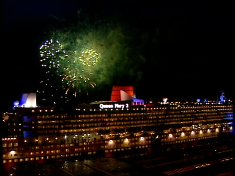 Hampshire Southampton GV Fireworks exploding over the new cruise liner Queen Mary 2 at naming ceremony LA MS Fireworks burning along the length of...