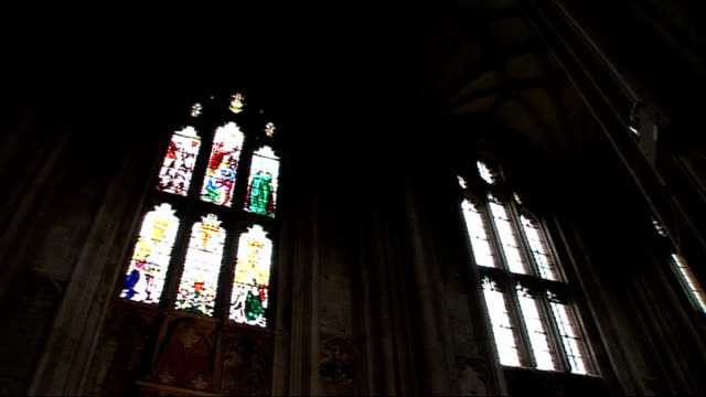 winchester: int **organ music overlaid sot** interiors of winchester cathedral, including stained glass windows, lit candles, some sign of water... - cathedral stock videos & royalty-free footage