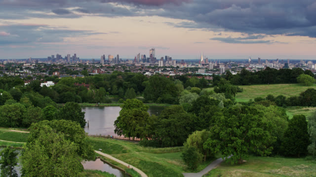 hampstead heath ponds with london in distance - aerial - parliament hill stock videos & royalty-free footage