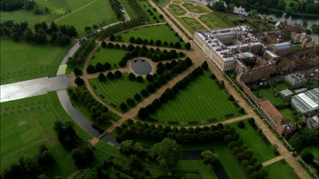 hampton court  - aerial view - england, greater london, richmond upon thames, united kingdom - royalty stock videos & royalty-free footage