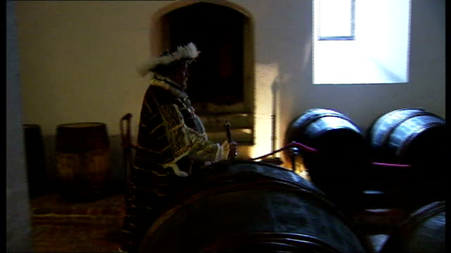 hampton court prepares for henry viii anniversary celebrations **flashlight 'henry viii' acts out arm wrestling scene in wine cellars - arm wrestling stock videos & royalty-free footage