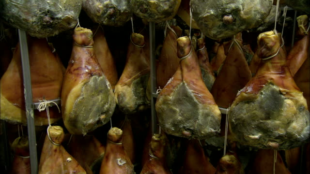 hams dry during the prosciutto making process. - drying stock videos & royalty-free footage