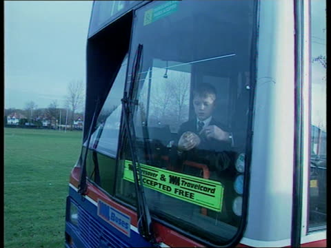 West Midlands Solihull Schoolboy Wayne Bass seated on bus with 'Sweep' the hamster in cage beside CMS Sweep in cage PULL OUT Wayne beside EXT TCMS...