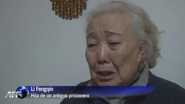 stockvideo's en b-roll-footage met han pasado decadas desde que el padre de li fengqin sufriera una horrible muerte cuando doctores japoneses le cortaron en dos pero ella espera que... - padre