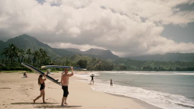 hanalei beach surfers - hawaii islands stock videos & royalty-free footage