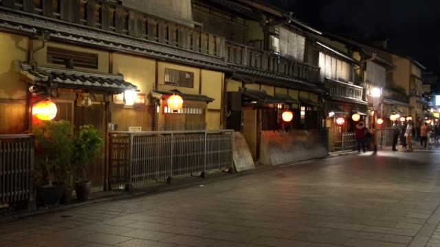 hanami-koji stret in gion by night - gion stock videos and b-roll footage