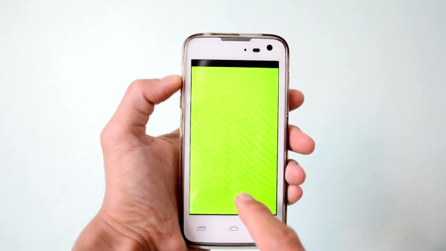 hand action on green screen of smart phone