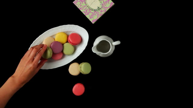 ms hand adding macaroon on others / seoul, south korea - macaroon stock videos and b-roll footage