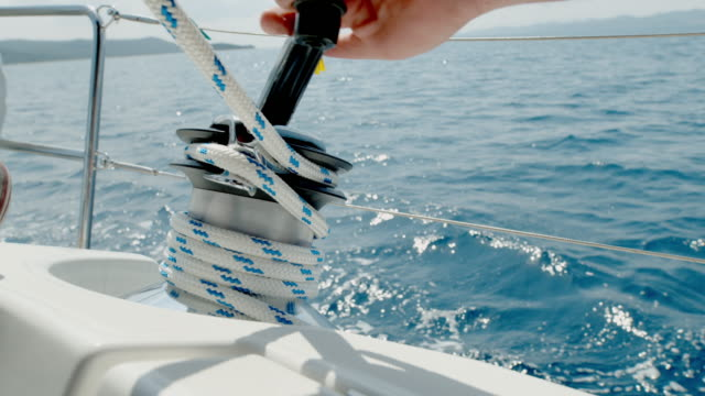 cu hand adjusting rigging on sailboat - yachting stock videos & royalty-free footage