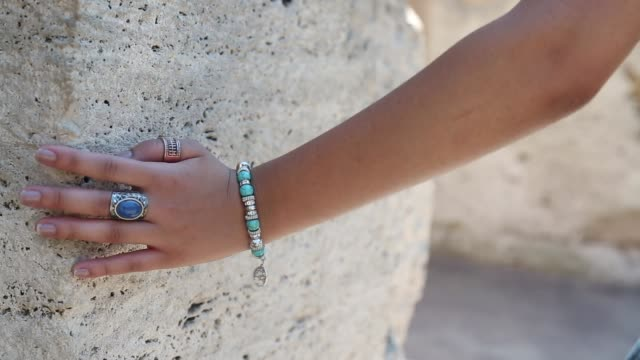 hand along rock wall - bracelet stock videos and b-roll footage