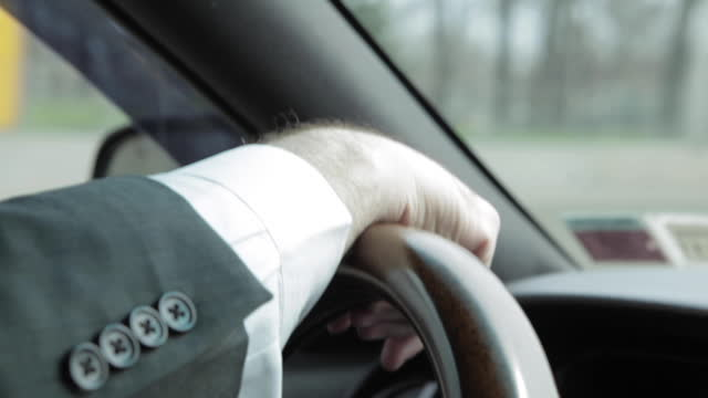 hand and cuff on a steering wheel - chauffeur stock videos & royalty-free footage