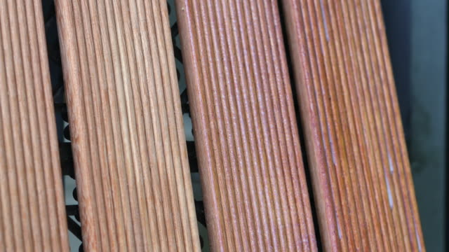 hand applying deck stain with a large paintbrush - stained stock videos & royalty-free footage
