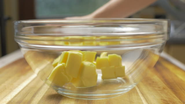 hand beat butter with sugar together for making cookie - butter stock videos & royalty-free footage
