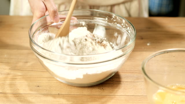hand beat cake mix - flour stock videos & royalty-free footage