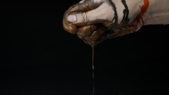 Hand black background colorful paint slow motion caucasian human