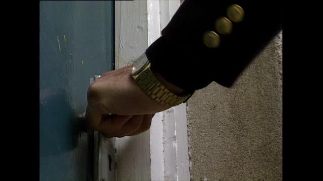 hand calmly turns handle on squeaking locked door; 1993 *audio* - 1993 stock videos & royalty-free footage