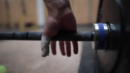 Hand Catches Weight In Gym