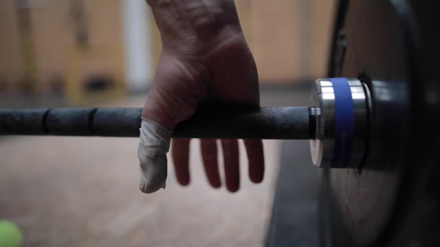 hand catches weight in gym - gripping stock videos and b-roll footage
