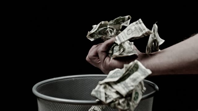 slo mo hand catching crumpled dollar bills - crisis stock videos & royalty-free footage