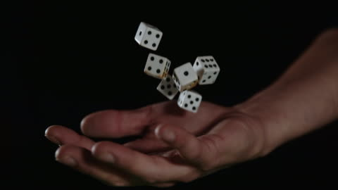 slo mo hand catching gambling dices - gambling stock videos & royalty-free footage