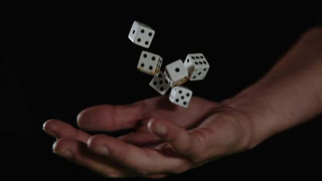 slo mo hand catching gambling dices - luck stock videos & royalty-free footage