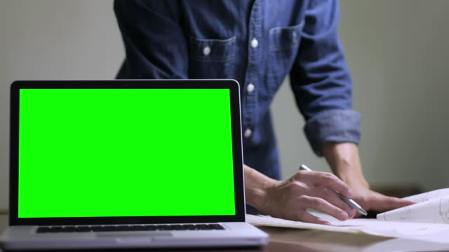 hand checking blueprint work with green screen - watch stock videos and b-roll footage