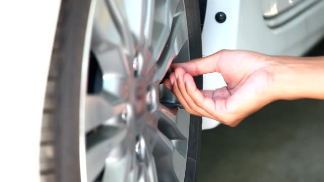 hand checking tire pressure - physical pressure stock videos & royalty-free footage