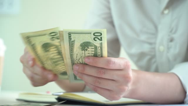 hand counting dolla bill money close up - paying stock videos & royalty-free footage