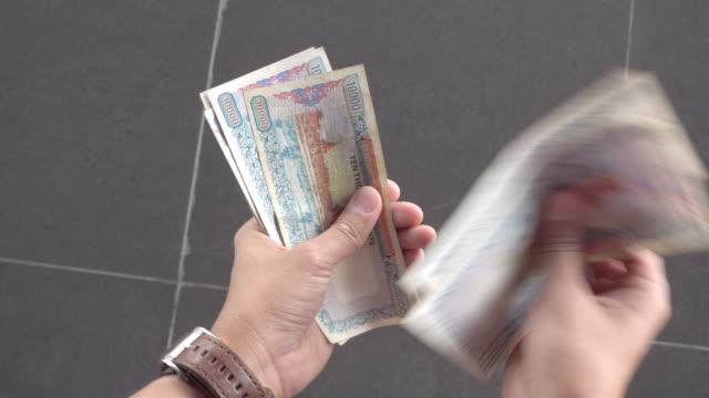 hand counting myanmar money bank note - bill legislation stock videos & royalty-free footage