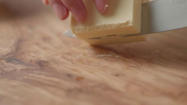 hand cut block butter into cubes - butter stock videos & royalty-free footage