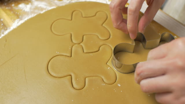 hand cut gingerman bread on wooden cutting board - biscuit stock videos & royalty-free footage